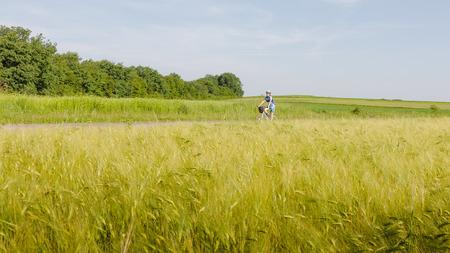 Woman cycling at the road