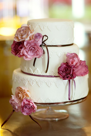 decorative wedding cake at wedding reception. Stock Photo