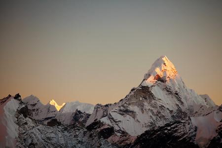 alpinism: Ama Dablam peak at sunset.  Stock Photo
