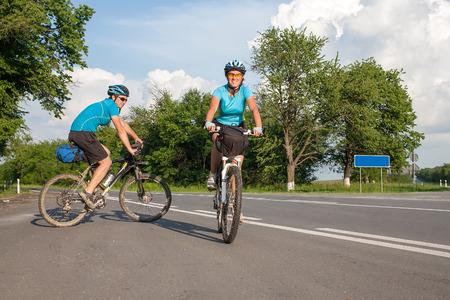 road cycling: Woman cycling at the road