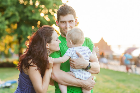 Young Attractive Parents and Child Portrait Outdoors photo