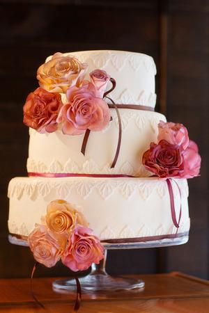 wedding table setting: decorative wedding cake at wedding reception. Stock Photo