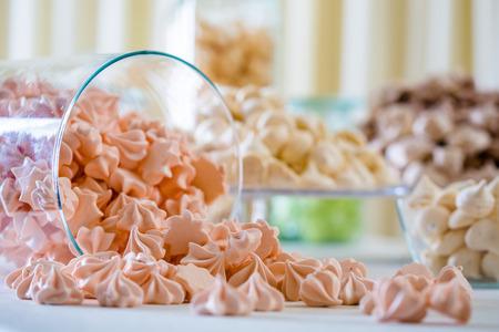 Colorful meringue closeup at white table
