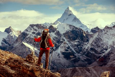 Hiker posing at camera on the trek in Himalayas, Nepal photo