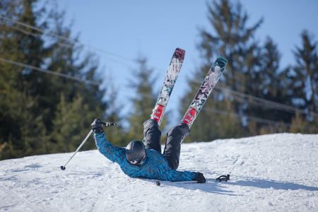 Skier fell during the descent from the mountain photo