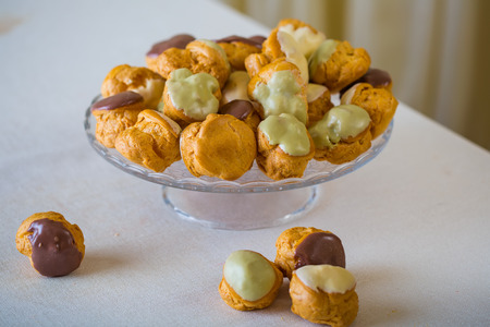 Profiterole, cream puff - French dessert choux pastry ball filled with whipped cream photo