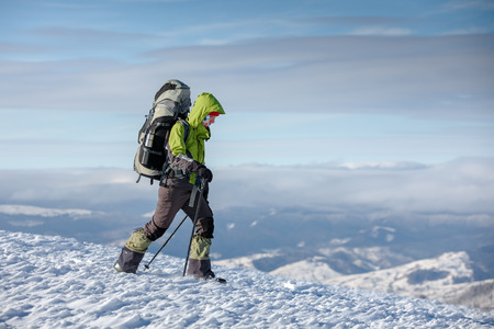 adventure holiday: Hiker in winter mountains Stock Photo