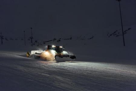 snowcat: Snowcat cleaning slope in night at snow resort of Gudauri, Georgia