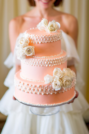 tiered: Wedding cake in bride Stock Photo