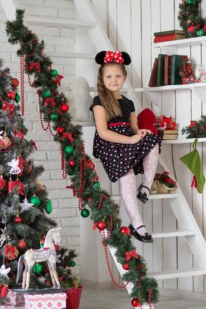 Kid near new-year tree photo