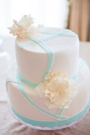 wedding cake: wedding cake with individual decoration at withe table