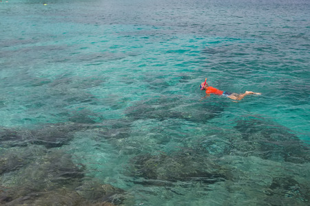 snorkle: Man snorkeling in blue Indian ocean Stock Photo