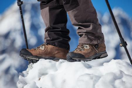 wellfare: Hiking boot closeup on mountain rocks