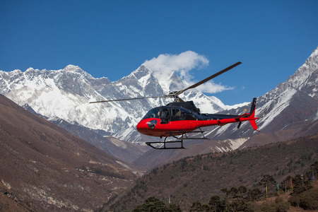 rescue helicopter: Lifeguard helicopter in Himalaya mountains in Nepal