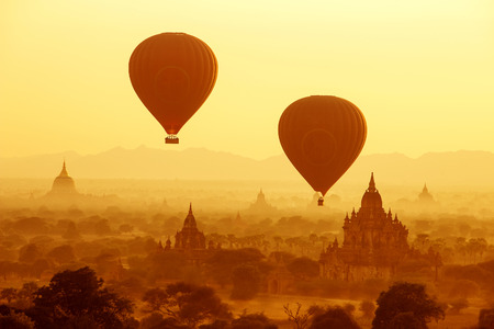 bagan: air balloons over Buddhist temples at sunrise. Bagan, Myanmar. Stock Photo