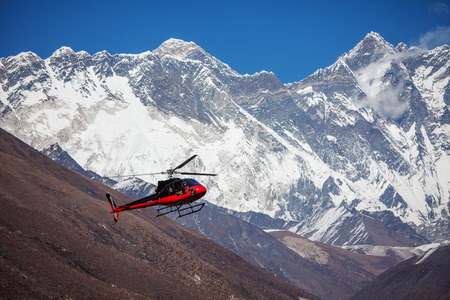 bazar: Lifeguard helicopter in Himalaya mountains in Nepal