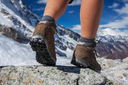 hiking boot: Hiking boot closeup on mountain rocks