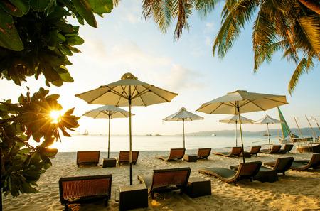boracay: Sun umbrellas and beach chairs on tropical beach, Philippines, Boracay
