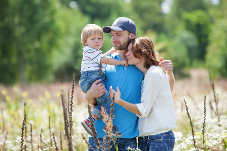 one eyed: Young Attractive Parents and Child Portrait Outdoors Stock Photo