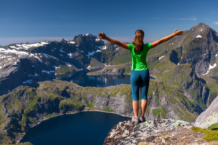 woman mountain: Woman takes rest on top of mountain in Norway Stock Photo