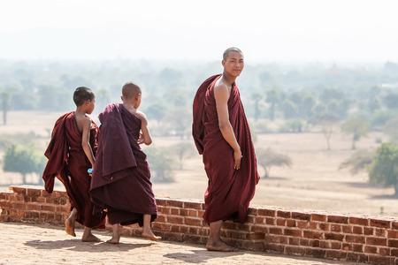 monks: Monks visit Bagans pagodas, Myanmar Editorial