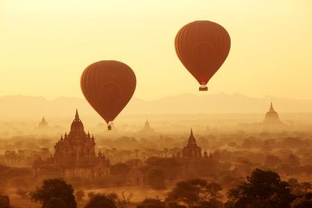 bagan: air balloons over Buddhist temples at sunrise. Bagan, Myanmar. Stock Photo