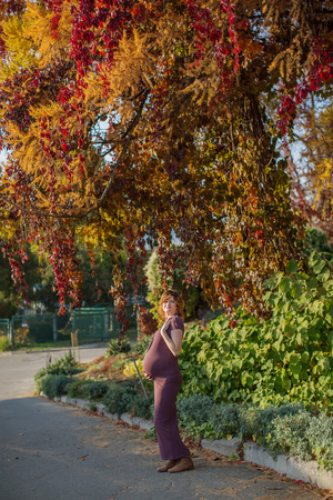 womanlike: Pregnant female in autumn