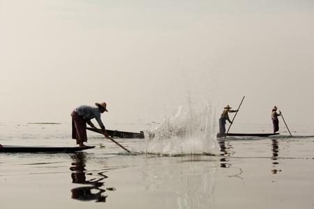 inle: Fishermen in Inle lakes sunset, Myanmar.