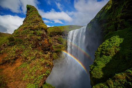 skogafoss waterfall: Skogafoss Waterfall during a sunny day Stock Photo