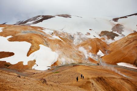 geothermal: Hiker in Iceland geothermal hot spring field Kerlingafjoll, Iceland