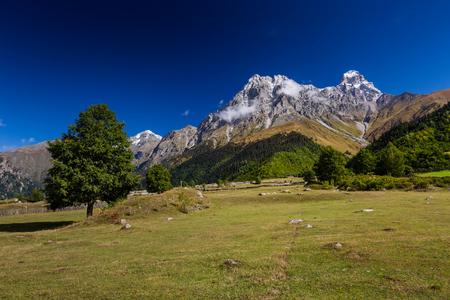 upper: View at Ushba mountain in Upper Svaneti, Caucasus, Georgia