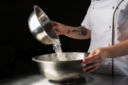 kneading: Woman hands kneading dough. Stock Photo