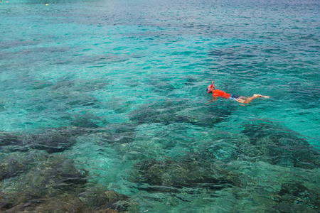snorkle: Man snorkeling in blue Indian ocean Stock Photo