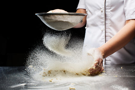 Woman hands kneading dough. Standard-Bild