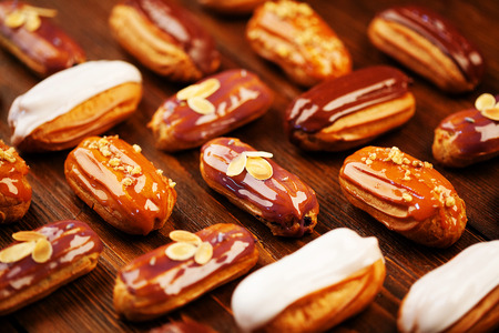 Eclairs on wooden table Stock Photo