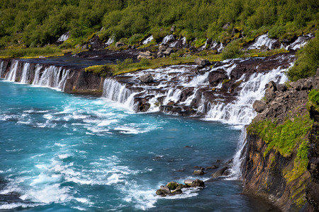 Hraunfossar series of waterfalls formed by rivulets streaming over a distance of about 900 metres  Stock Photo