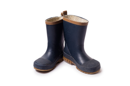 gumboots: Blue worn gumboots on white background
