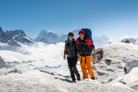 Trekkers in Khumbu valley on a way to Everest Base camp Stock Photo
