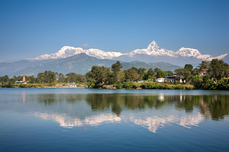 phewa: View at Annapurna mountain range and its reflection in Phewa lake in Pokhara, Nepal