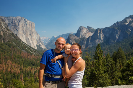Family with infant visit Yosemite national park in California