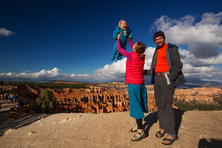 Family with babyboy in Bryce canyon National Park, Utah, USA Stock Photo