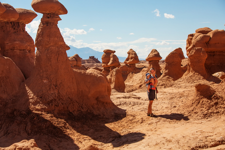 A mother and her baby son visit Goblin valley state park in Utah, USA Stock Photo