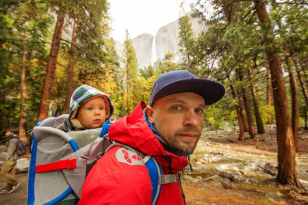 dome of the rock: A father with baby son visit Yosemite National Park in Californai, USA