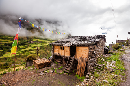 View to the poor village in highlands of Himalayas Stock Photo