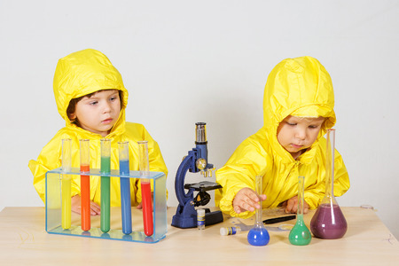 Children play chemists game at home