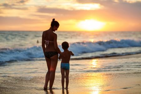 Family has fun at the seashore in summertime
