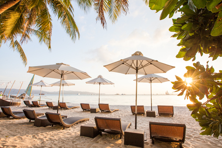 Chaise longues at the beach on the Boracay island, Philippines Stock Photo