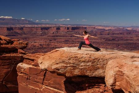 Woman meditating doing yoga in Canyonlands National park in Utah, USA Stock Photo