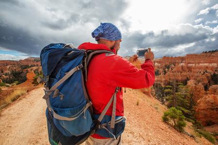 Hiker visits Bryce canyon National park in Utah, USA Stock Photo