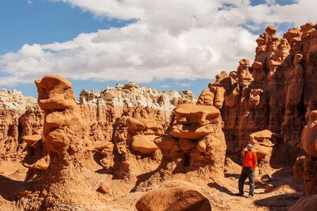 Hiker visit Goblin valley state park in Utah, USA